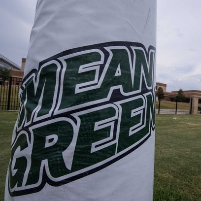 A view of the Mean Green logo during the University of North Texas fall football practice.