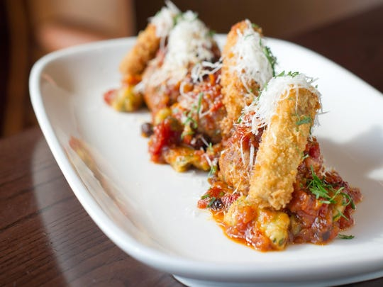 In addition to sushi, Nikko served Mediterranean dishes like this one: roasted lamb meatballs with swiss chard and ricotta gnocchi, currants, pine nuts and capers in a roasted tomato sugo, served with fried eggplant.