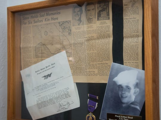 Newspaper stories, a Purple Heart and a letter of commendation from Admiral Chester William Nimitz hang in Cindy Cheyne's home in honor of her dad Floyd Head.