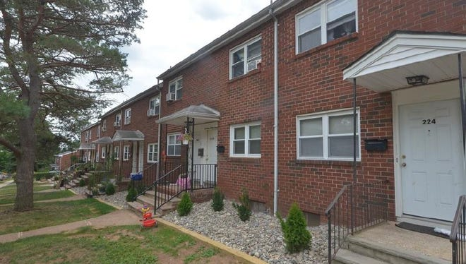 This garden apartment complex in Highland Park is one of two Middlesex County properties recently brokered by Redwood Realty Advisors .