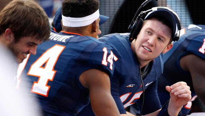 Sep 6, 2014; Charlottesville, VA, USA; Virginia Cavaliers quarterback Matt Johns (15) talks with Cavaliers wide receiver Andre Levrone (14) on the bench against the Richmond Spiders in the fourth quarter at Scott Stadium. The Cavaliers won 45-13. Mandatory Credit: Geoff Burke-USA TODAY Sports