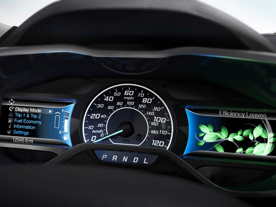 "Drivers can play with the SmartGauge where leaves ""grow"" and ""shrivel"" in the instrument cluster, depending on how ecologically the 2014 Ford C-MAX Energi is driven. Brake Coach puts a gauge in the cluster that emphasizes smart regenerative braking skills."