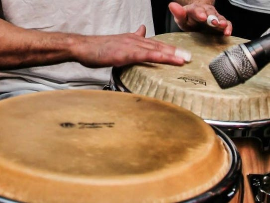 La Murella musician plays the bongos.