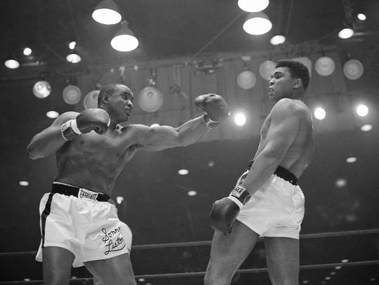 Muhammad Ali steers clear of the left arm of Sonny