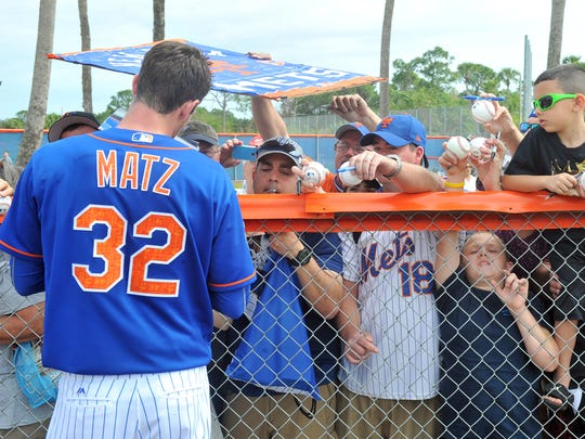 The New York Mets' first full squad workout is Sunday at Tradition Field. In this 2016 photo, pitcher Steven Matz signs autographs for fans.