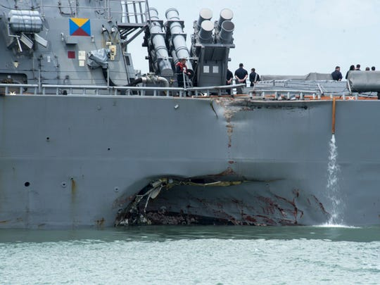 Damage to the portside is visible as the Guided-missile