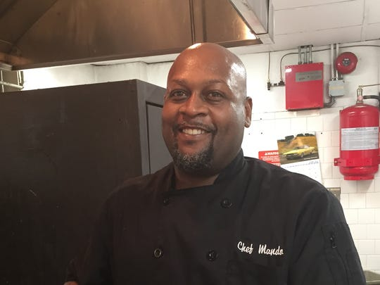 Famando Poole, head chef at Let's Eat at Byron's, creates homemade barbecue dishes for the new bar, Byron's Gear House Lounge.