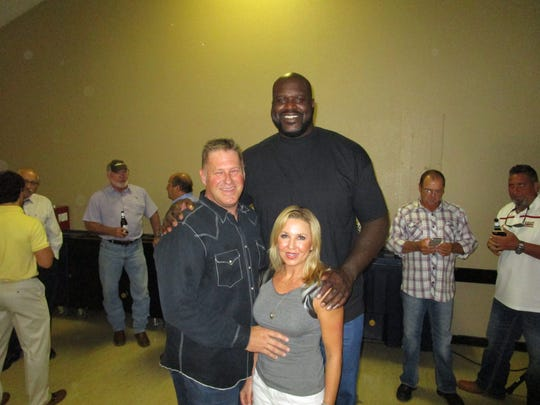 Basketball legend Shaquille O'Neal in Lafayette to attend a party for Lafayette City Marshal, Brian Pope.