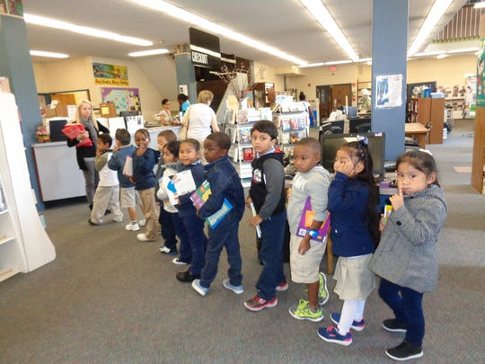 Sasha Earl, a kindergarten teacher at Bridgeton Public Charter School, and her students are lined up and ready to leave the Cumberland County Library in Bridgeton.