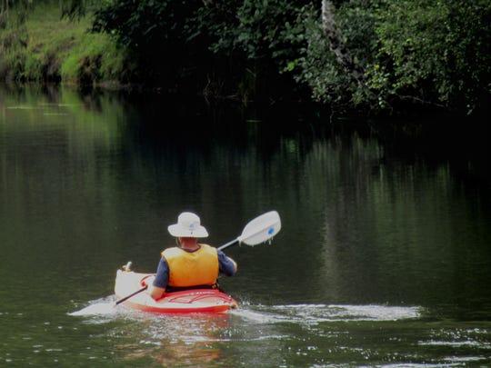 A kayaker explores Beaver Creek at Ona Beach.
