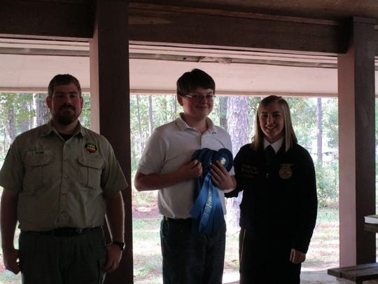 Peyton Henson placed first overall for middle school.