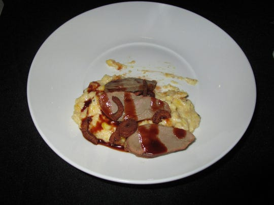 Duck with chocolate sauce