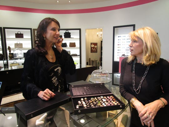 Erica Courtney and Kiki Frayard discuss jewelry during the designer's trunk show at Kiki in River Ranch, Dec. 3, 2015.