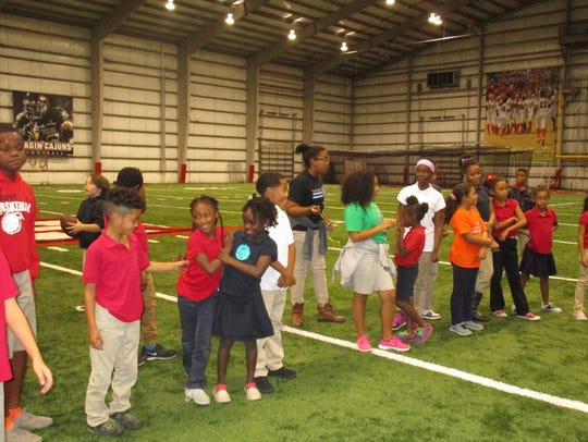 Boys & Girls Clubs members play at the UL Football