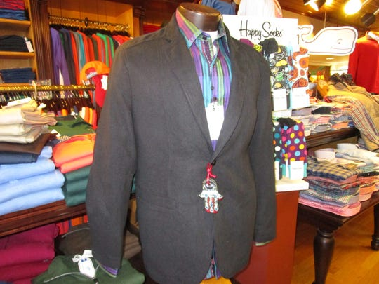 Both the jacket and the elegant dress shirt are available at Brother's for under $500.