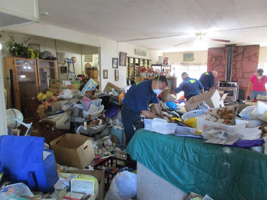 """Disposable masks were necessary for a team of ServiceMaster employees, including four from Salem, as they helped with cleanup during the filming of an episode of """"Hoarders"""" that features an Oregon couple."""