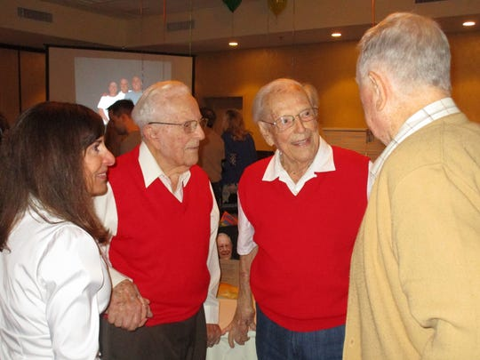Family and friends gather at the Homewood Suites in Lafayette for he Pfeufer twins 100th birthday party.