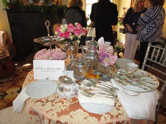 """A table set with a """"Downton Abbey"""" theme at the """"Vignettes"""" fundraiser for the Alexandre Mouton House."""