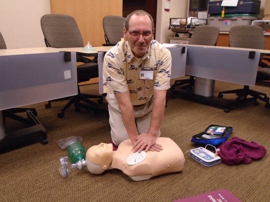 Mike Linley demonstrates life-saving techniques such as CPR on high-tech dummies.