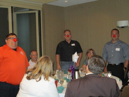 Attendees at the Big Brothers Big Sisters of Manitowoc County's Appreciation Dinner May 25 don red noses in recognition of Red Nose Day.