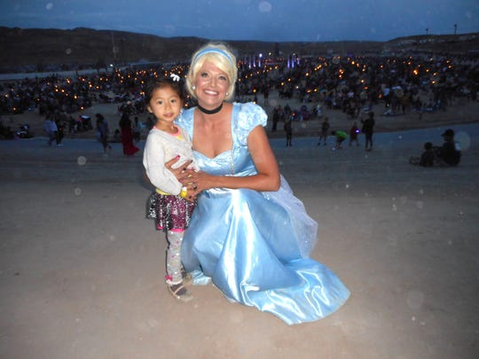 Giselle Yang poses at the Lantern Fest with Disney  princess Cinderella, played by Heidi Figueroa, owner of Fun Events NV, Saturday at Reno-Fernley Raceway.