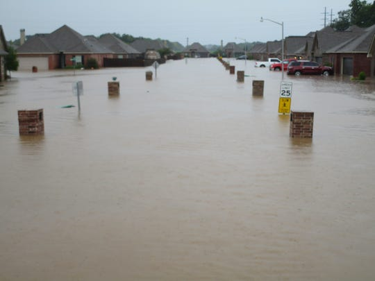 A flooded street in the Highland Ridge neighborhood in Youngsville.