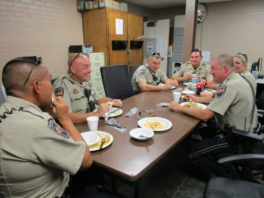 Lafayette Parish Sheriff's deputies enjoy a surprise Labor Day lunch from the Olive Garden restaurant on Mon. Sept. 5 2016.