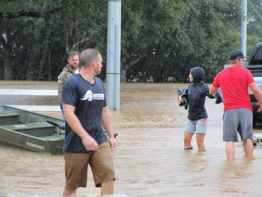 Residents of Youngsville prepare to evacuate as flood waters rise in the area. August 13, 2016.