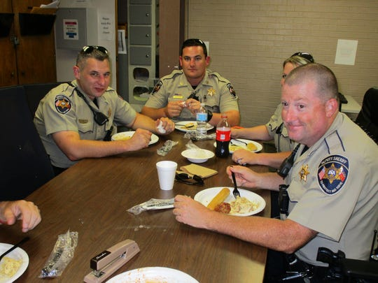 Lafayette Parish Sheriff's deputies enjoy a lunch provided by Olive Garden in Lafayette to honor first reponders.