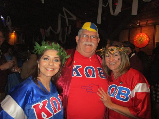 Denise Giosa, Gene and Julia Lognion attend a Krewe of Bonaparte party at Feed and Seed in Lafayette.