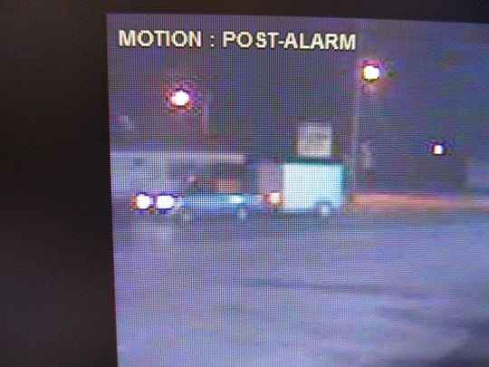 A blue Ford Ranger is seen on surveillance footage pulling a stolen trailer from a Hebron business.