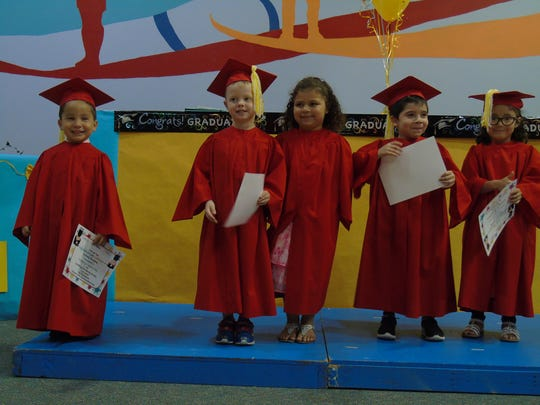 Children from Day Nursery of Abilene's Sherry Lane Center celebrate school-readiness following completion of the pre-k program, part of a partnership with Abilene ISD which provides instruction by certified teachers.