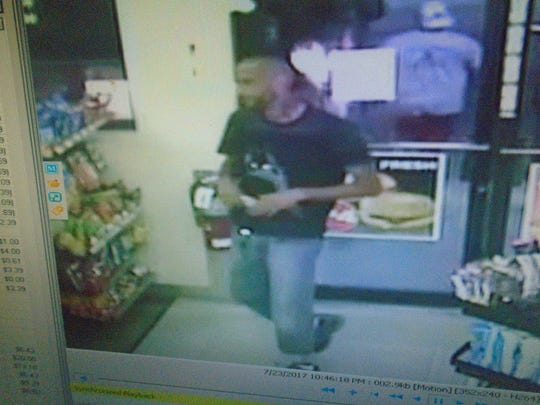 One of two suspects alleged to have taken lottery tickets from a south Fort Myers convenience store.