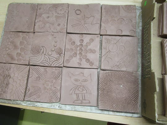 Pictured are tiles that participants created in Kathryn Dreifuerst's workshops during her summer artist residency at the Idea Studio.