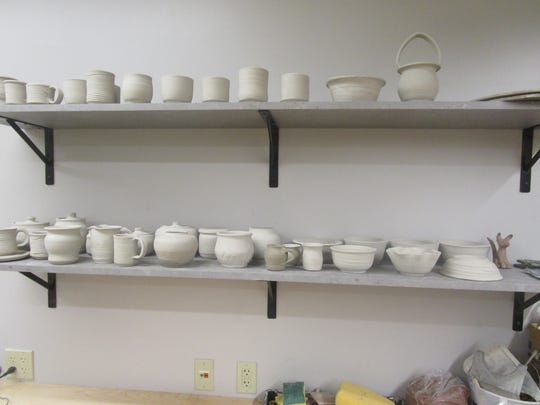 During the Idea Studio summer artist residency, Kathryn Dreifuerst created multiple ceramic pieces, including tiny pitchers.
