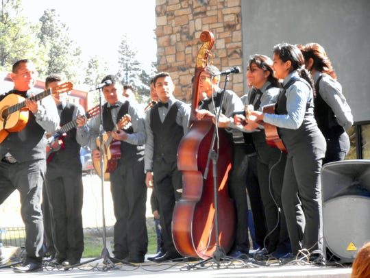 Musicians from Juarez. Mexico sang and played instruments
