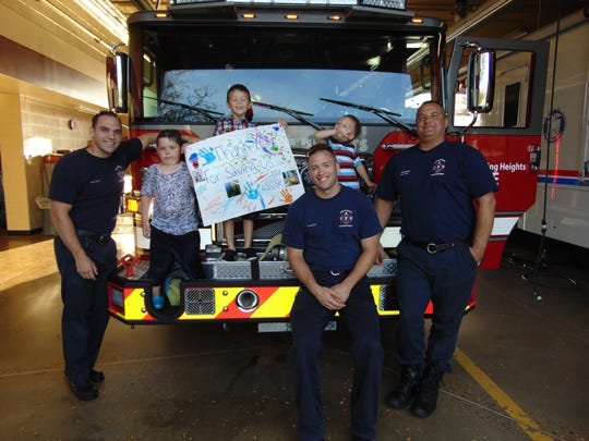 On Monday, Sept. 25, three boys thanked Sterling Heights firefighters with a poster, for rescuing them from a gun safe Sunday afternoon.