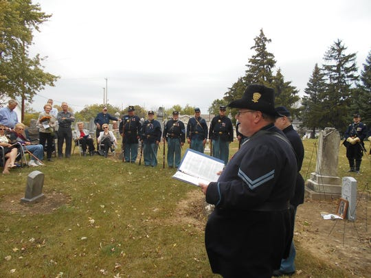 Kent Peterson reads an account of one of his relative's battles in the civil war. His relative served in the 28th Wisconsin Infantry alongside William Kolbow.