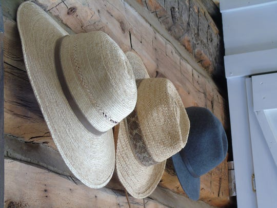 A trio of hats hang on the walls of Jessie Ferguson's