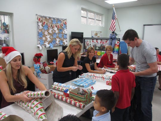 "A host of generous volunteers joined Patricia Weaver, Palm Beach County Commissioner Hal Valeche, Kim Ciklin and Henry Post last year at the Edna W. Runner Tutorial Center's annual holiday  ""Shop-a-thon"" wrapping station."