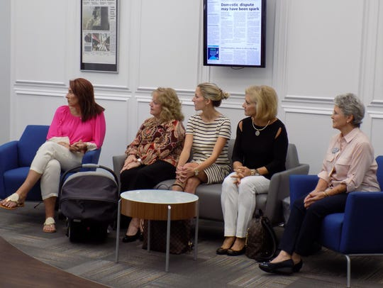 Attendees of the Go Pink awards listen to the presentation of Tallahassee's top earners Wednesday in the lobby of the Tallahassee Democrat.