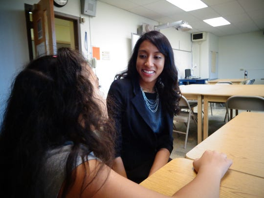 Jessica Stanis works with her mentee, Angelique Atkinson.