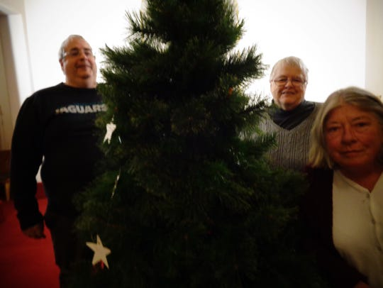 DawnMarie Kelleher, right, with the Giving Tree at