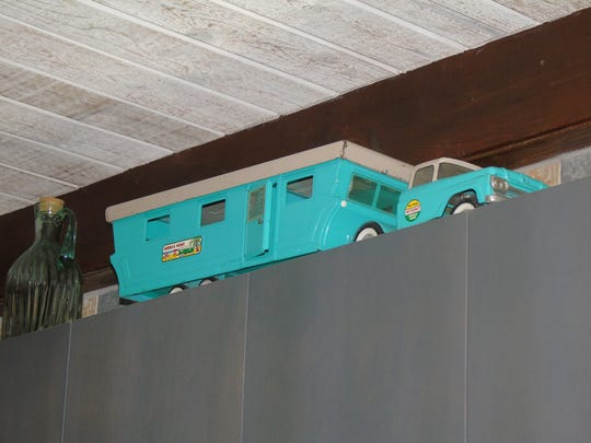 Michelle Losing has antique toy campers above her kitchen cabinets.