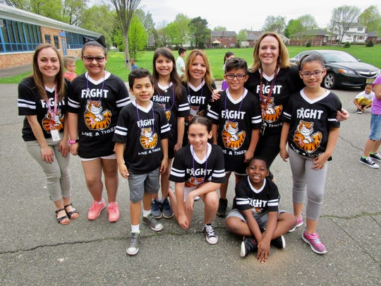 "Third-grade students and staff showing off their ""Fight Like a Tiger"" T-shirts at the School No. 10 ""Relay for Life"" on May 4. Back row: Student teacher Sherilyn Morse, Tatiana Rivera, Arabella Mohan, paraprofessional Denise Hessler, Kenneth Connelly, teacher Kim Marie Kefalas, and Isabella Moreira. Front row: Johan Delcarmen Lopez, Hadassah Correia and Jordan Merisca."