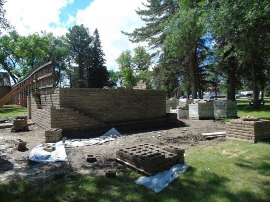 A blockhouse is under construction at historic Fort
