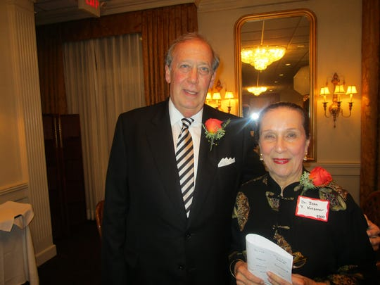 Dr. Jean Kreamer seen with last year's recipient of the Lafayette Civic Cup, Randy Haynie.
