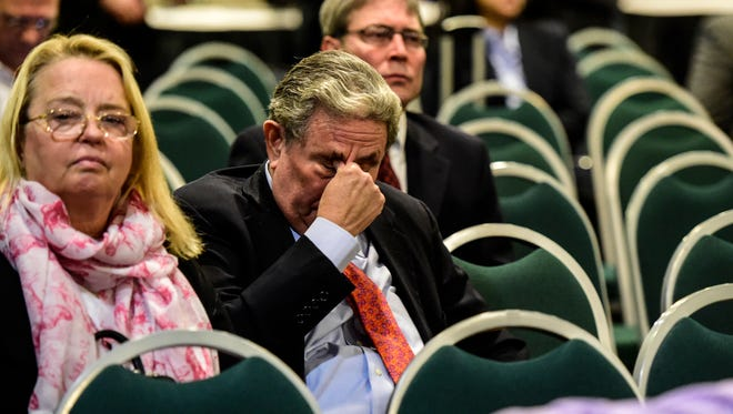 Jeff Gural, owner of Tioga Downs, wipes his eyes after casino-siting board did not recommend Tioga Downs for a casino license.