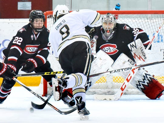 St. Cloud State's Jimmy Schuldt (22) and gaolie Charlie