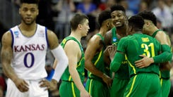 KANSAS CITY, MO - MARCH 25: Frank Mason III #0 of the Kansas Jayhawks reacts as the Oregon Ducks celebrate their late game lead during the 2017 NCAA Men's Basketball Tournament Midwest Regional at Sprint Center on March 25, 2017 in Kansas City, Missouri.  (Photo by Jamie Squire/Getty Images) ORG XMIT: 686517197 ORIG FILE ID: 657814624